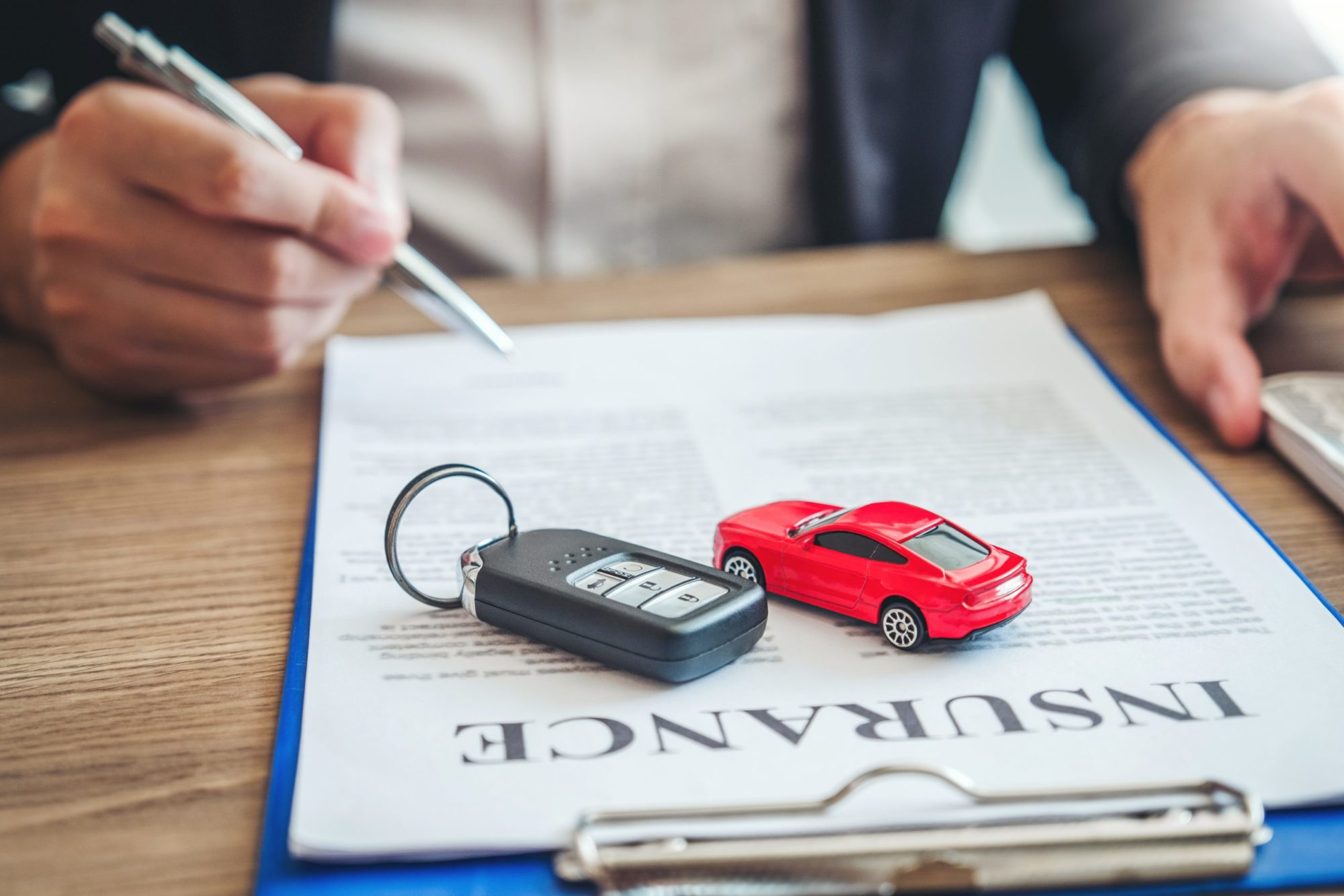Insurance agent helping to lower car insurance rates