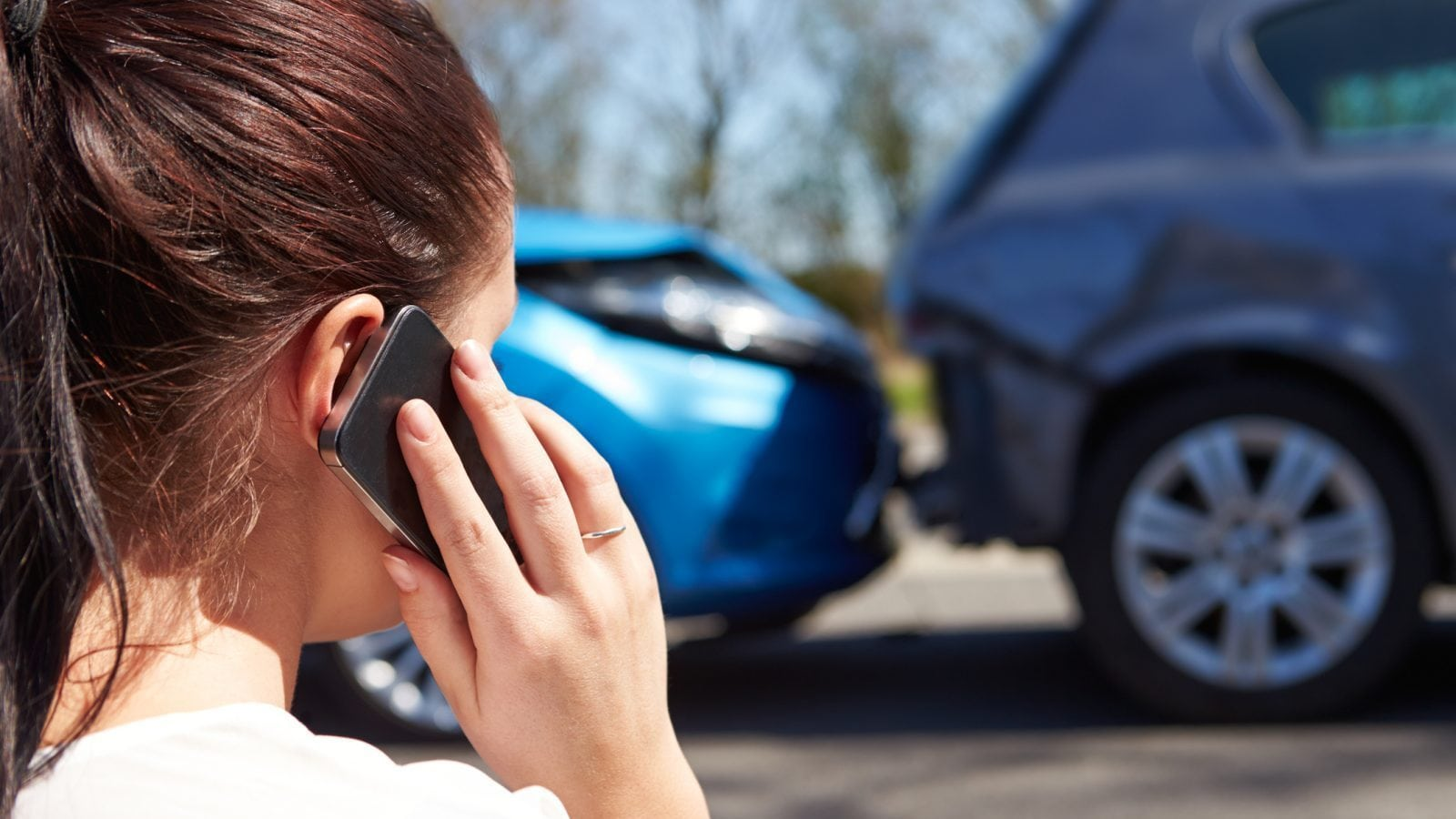 Woman Car Accident Aftermath Stock Photo