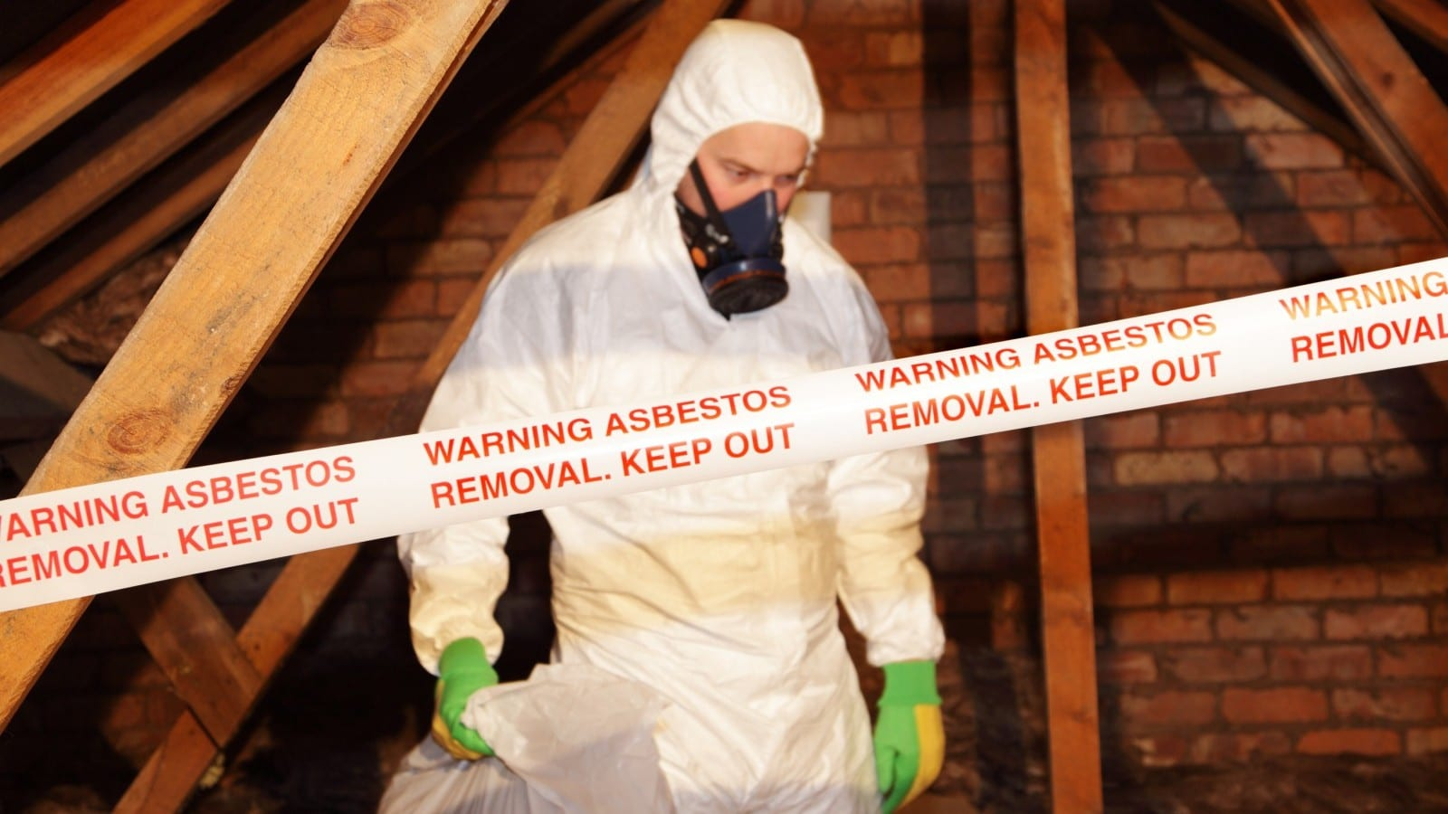Worker Removing Asbestos Stock Photo