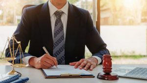 Attorney Signing A Document Stock Photo