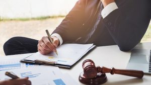 Lawyer Signing Legal Documents Stock Photo