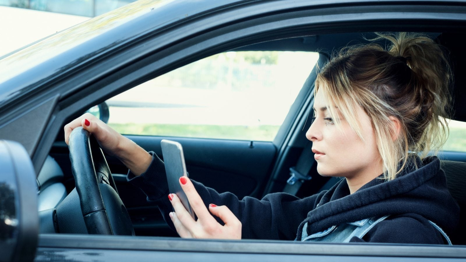 Distracted Woman Driving Stock Photo