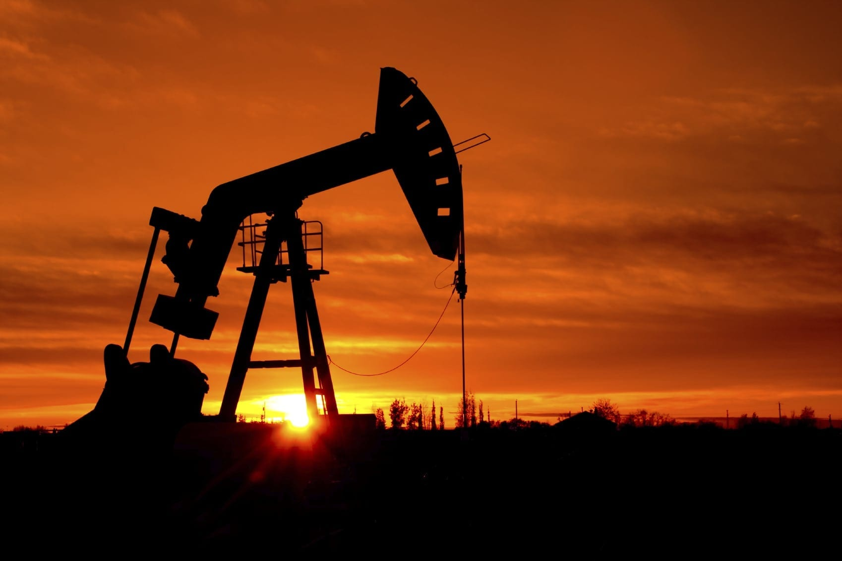 Oil Drill At Sunrise Stock Photo