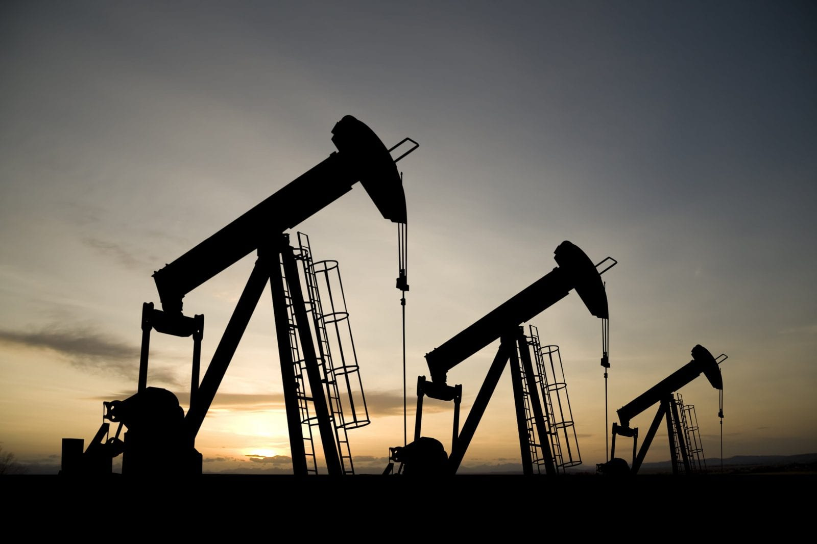 Stock photo of multiple oil drills. Oil Field Accident Attorneys.