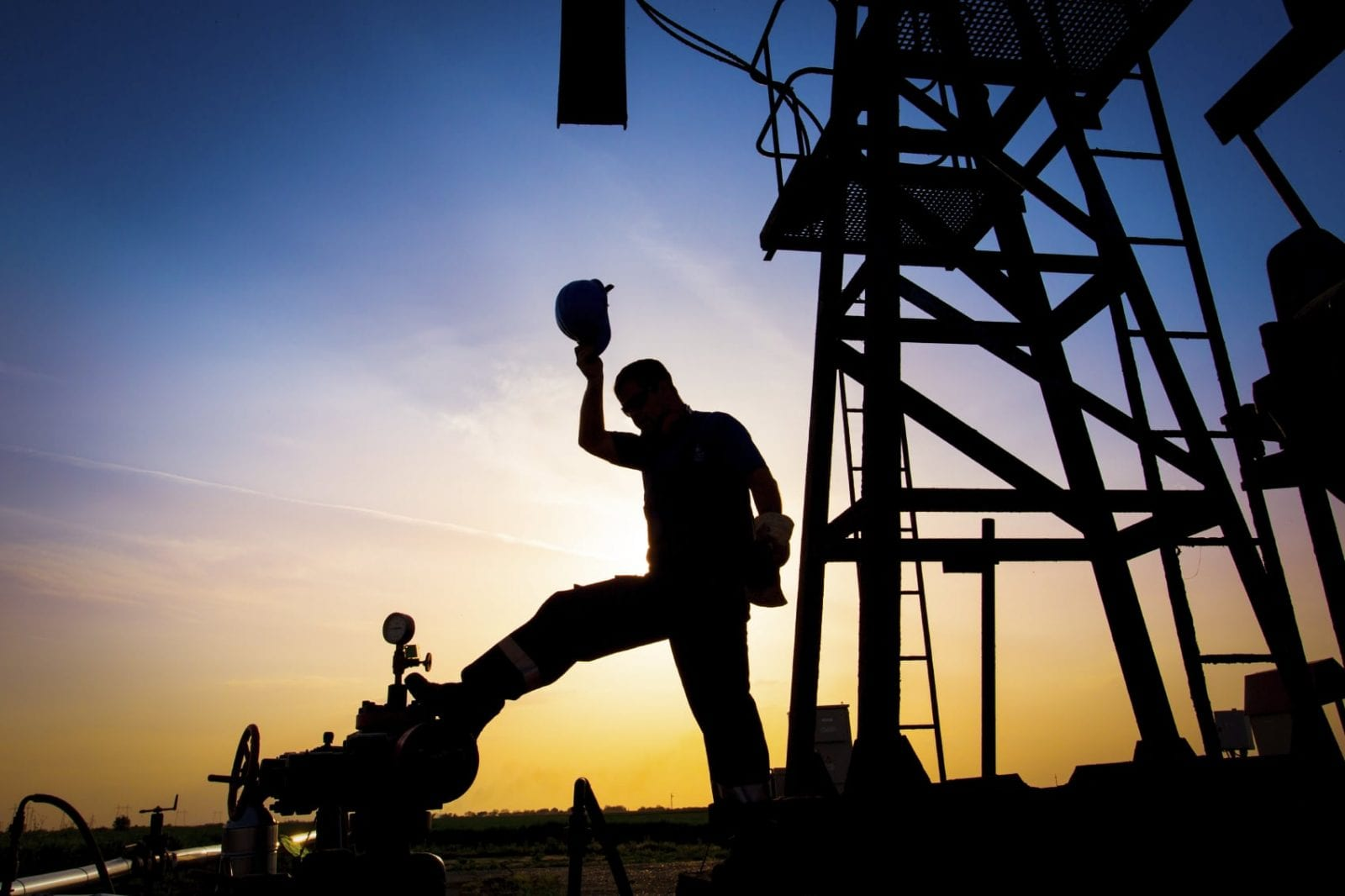 Oil Field Workers Stock Photo. Oil Field Accident Attorney Discusses Recent Houston Trial