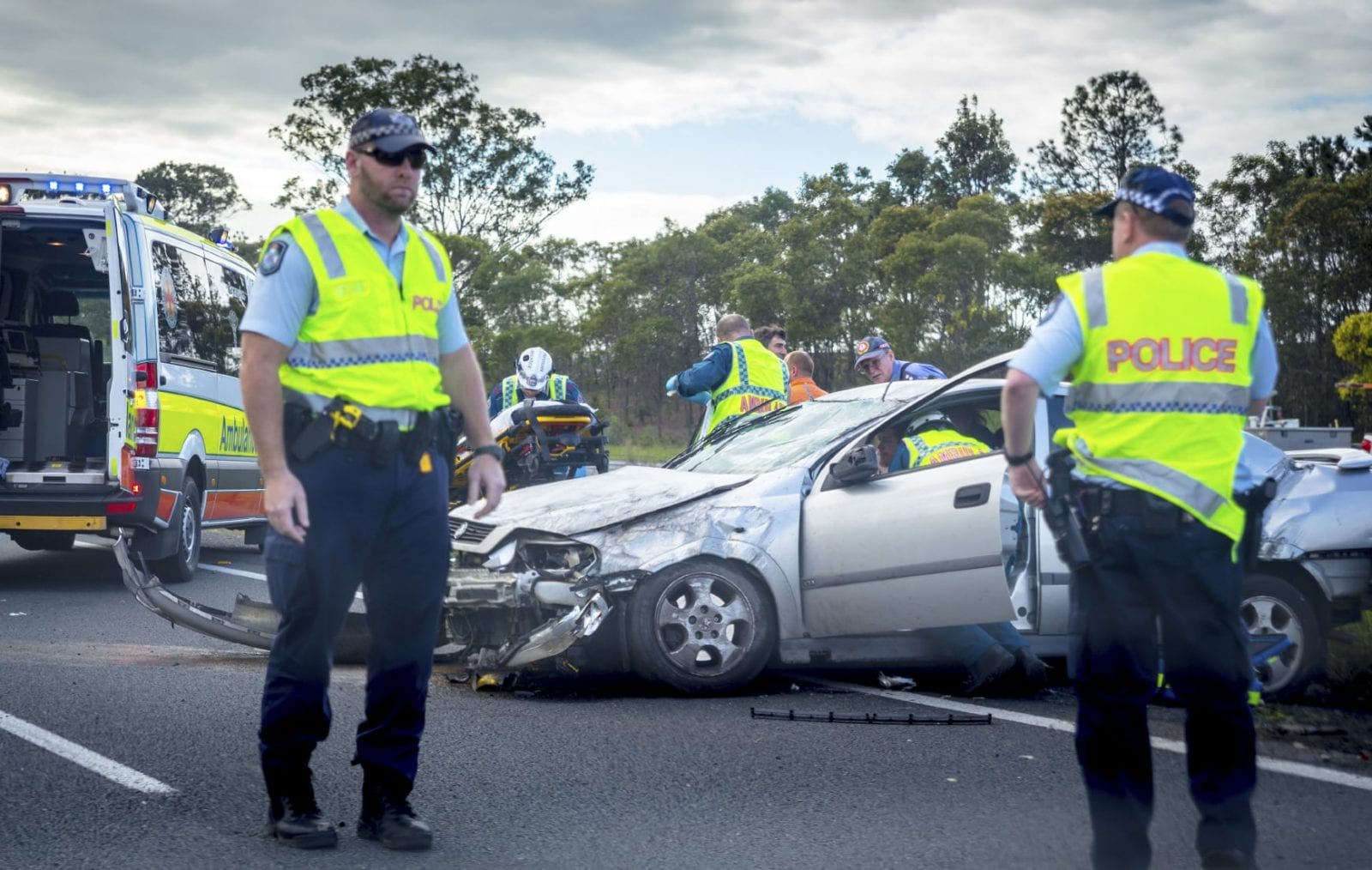 Stock Photo Of Police Examining The Scenes Of A Car Accident