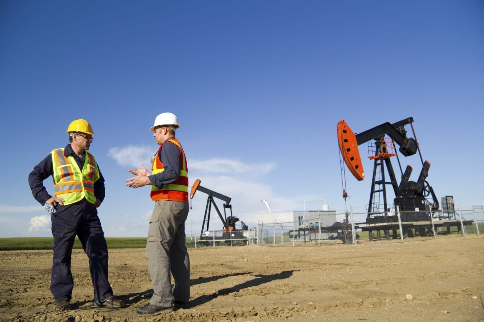 Oil Field Workers In Texas Stock Photo