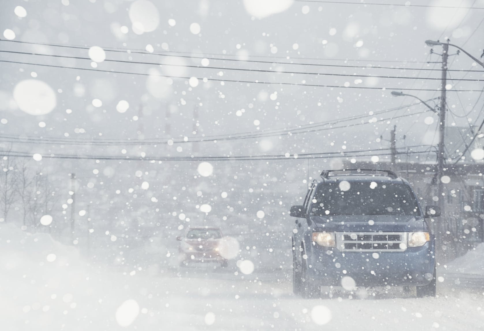 Cars Driving In Snow Stock Photo