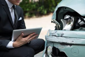 Insurance Adjuster Examining An Accident Stock Photo