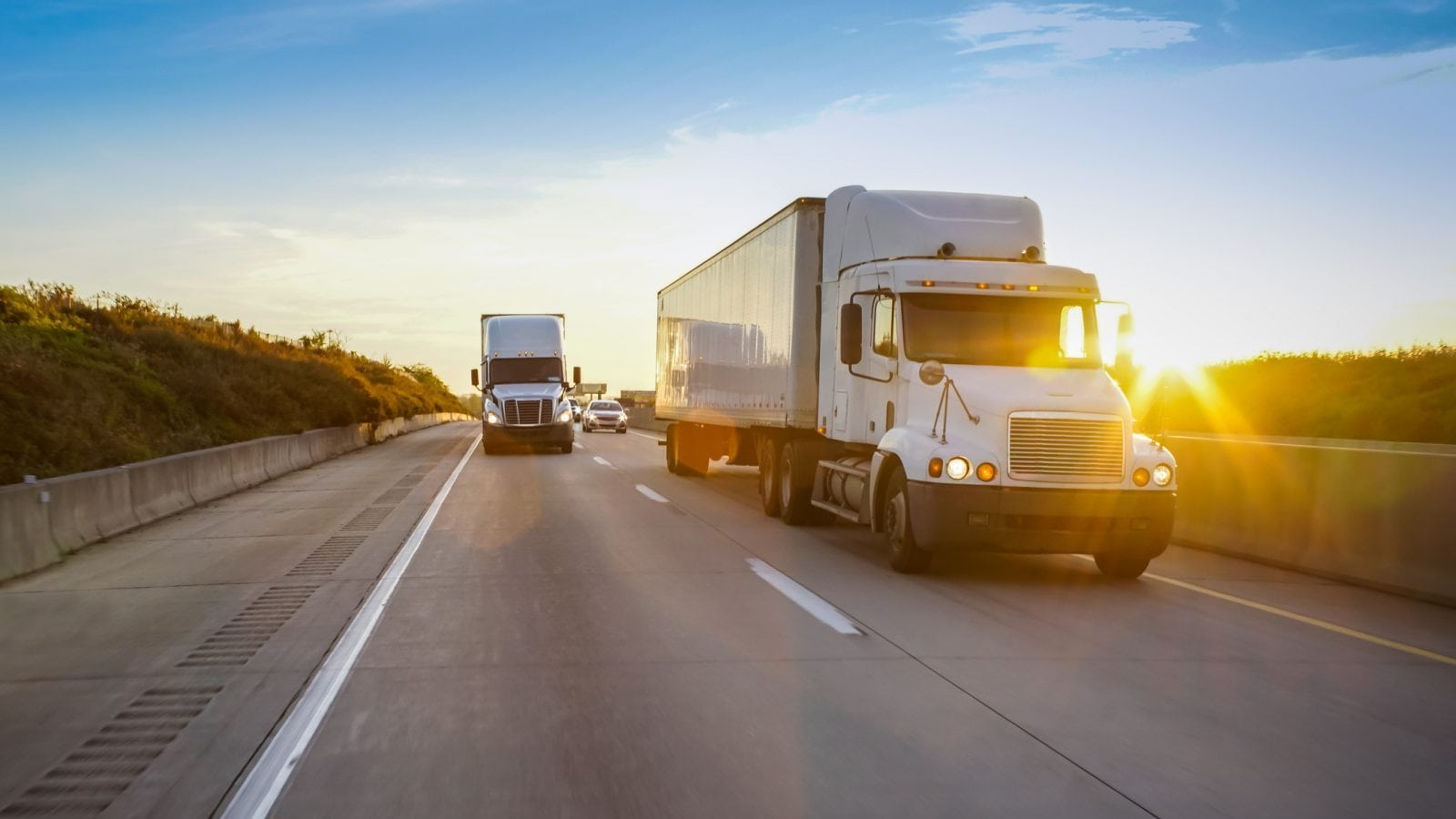 Semi-Trucks Driving On The Interstate Stock Photo