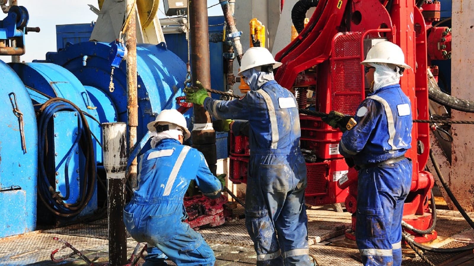 Oil Rig Workers Drilling Oil Stock Photo