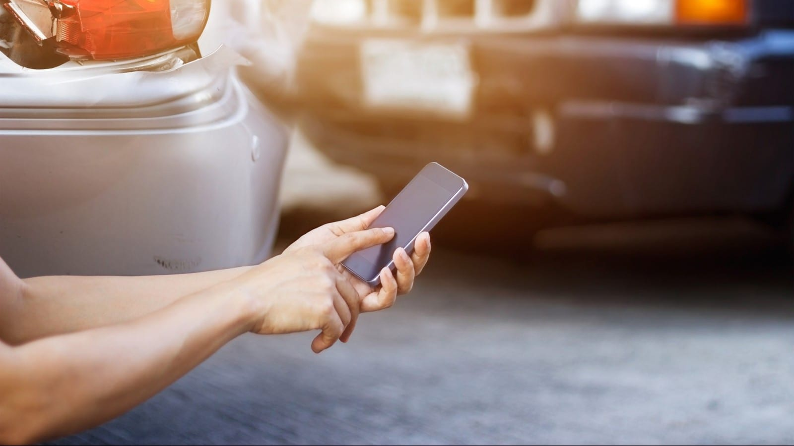 Smartphone Car Accident Stock Photo