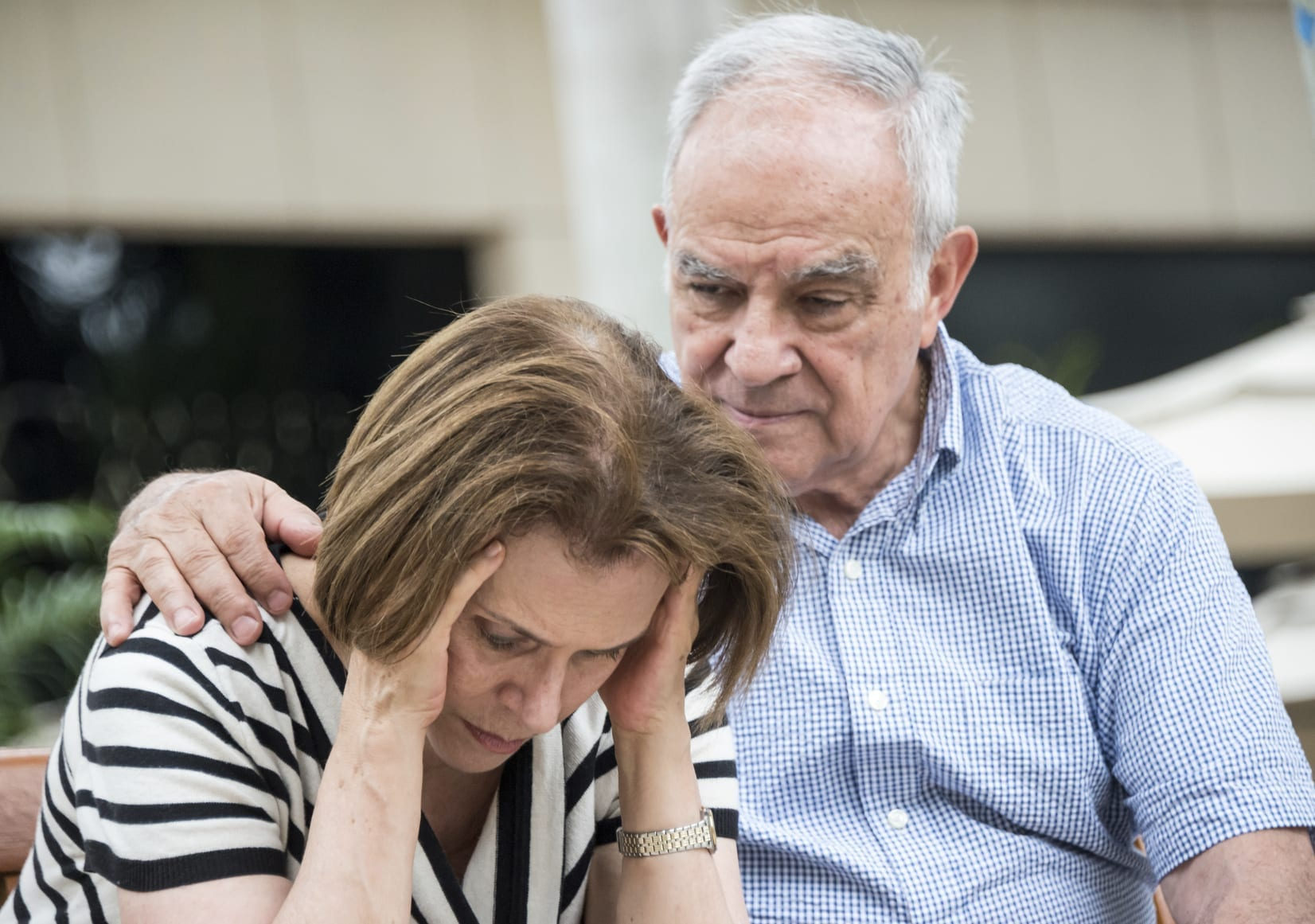 Consoling Elderly Wife Stock Photo