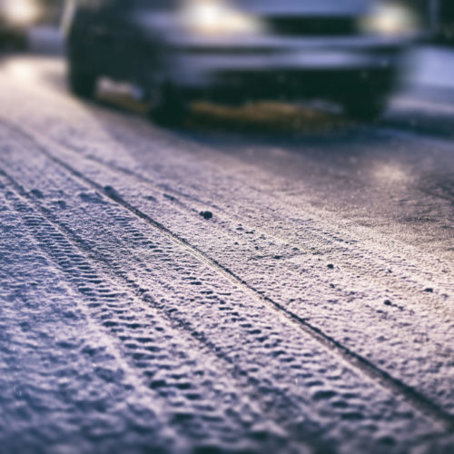 cars navigating winter weather in Odessa, TX