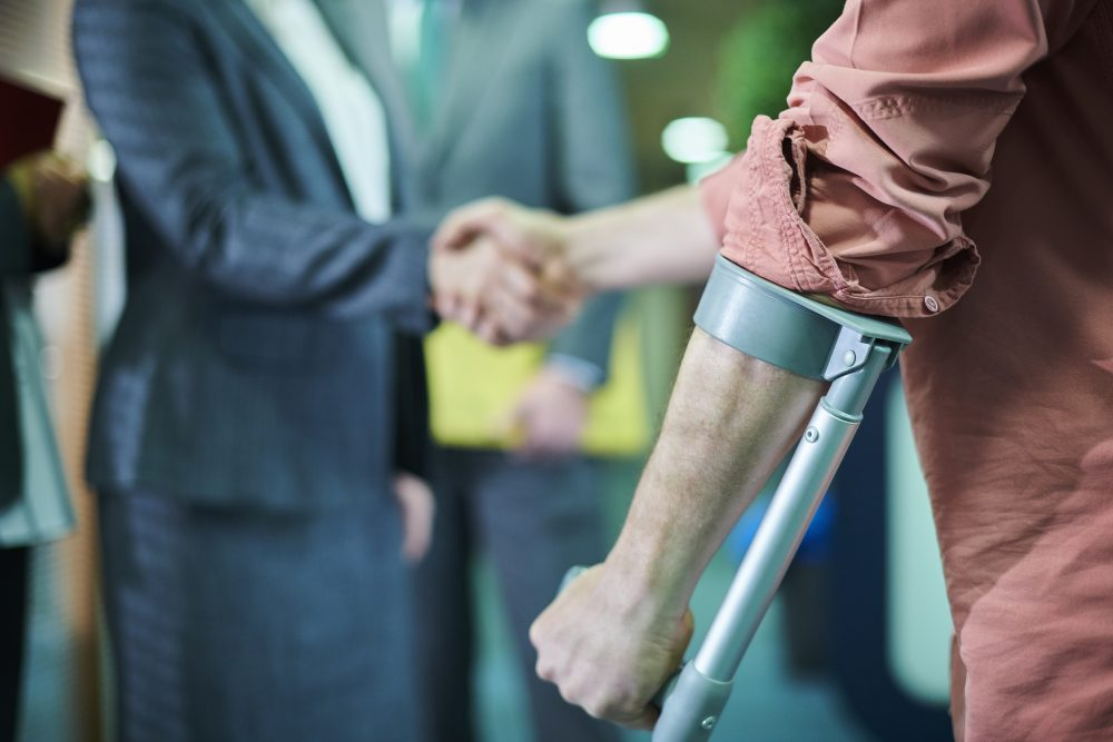 An injured man meeting with his car accident lawyer in Odessa, TX.
